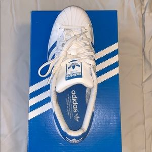Adidas tennis shoes. Barely worn!!